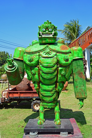 ANGTHONG,THAILAND - NOVEMBER 16, 2014 : The green giant robot made from scrap metal display at Ban Hun Lek