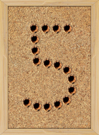 hardboard: Screw holes in shape of number five (5) on plywood texture in bamboo frame