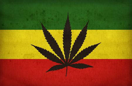 rastafari: Rasta flag with a marijuana leaf on fabric texture,retro vintage style Stock Photo