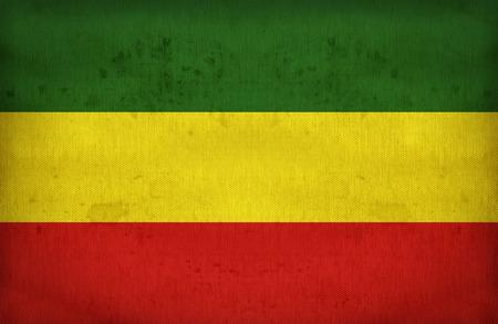 reggae: Rasta drapeau sur texture de tissu, style vintage r�tro Banque d'images