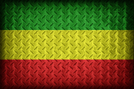 Rasta flag pattern on the diamond metal plate texture ,vintage style photo