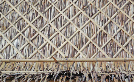 Thatched roof bamboo holder polished. Stock Photo