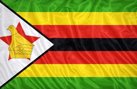 retrospective: Zimbabwe flag pattern on the fabric texture ,vintage style