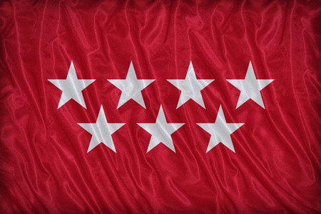 foreign land: Community of Madrid flag pattern on fabric texture, vintage style Stock Photo