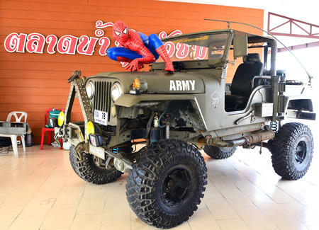 ayuttaya: AYUTTAYA,THAILAND - MARCH 04, 2015: Spider-Man model display on car at Thung Bua Chom floating market Editorial