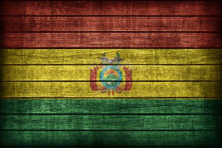 bandera de bolivia: Patr�n de la bandera Bolivia en textura de madera bordo, estilo retro vendimia