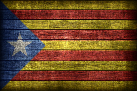 Catalan Independence blue estelada flag pattern on wooden board texture ,retro vintage style