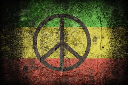 rastafari: Rasta flag pattern with a peace on dirty old concrete wall texture ,retro vintage style
