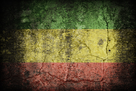 Rasta flag pattern on dirty old concrete wall texture ,retro vintage style