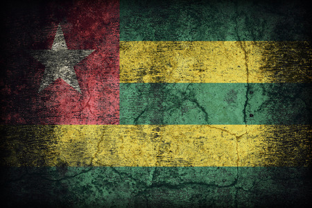 retrospective: Togo flag pattern on dirty old concrete wall texture ,retro vintage style Stock Photo