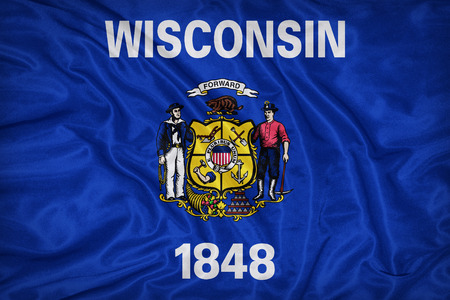 wisconsin flag: Wisconsin flag on fabric texture,retro vintage style Stock Photo