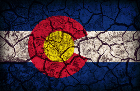 colorado flag: Colorado flag pattern on crack soil texture,retro vintage style