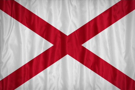 alabama flag: Alabama flag pattern with a peace on fabric texture,retro vintage style