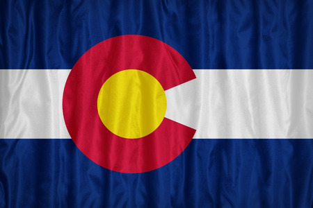 colorado flag: Colorado flag pattern with a peace on fabric texture,retro vintage style