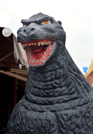 monster movie: AYUTTAYA,THAILAND - APRIL 25, 2015 : A Godzilla model stand outdoor at Thung Bua Chom floating market