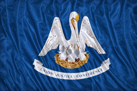 louisiana flag: Louisiana flag pattern on the fabric texture ,vintage style Stock Photo