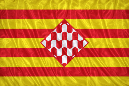 foreign land: Girona flag pattern on the fabric texture ,vintage style Stock Photo