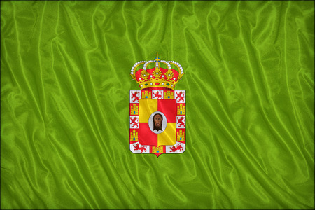 foreign land: Jaen flag pattern on the fabric texture ,vintage style Stock Photo