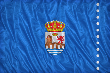 foreign land: Ourense flag pattern on the fabric texture ,vintage style