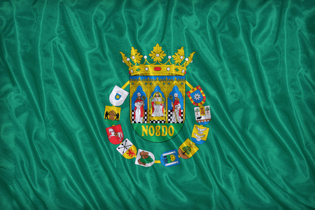 foreign land: Sevilla flag pattern on the fabric texture ,vintage style