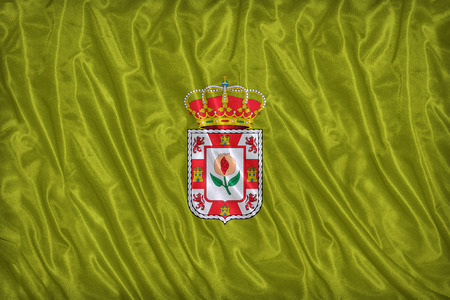 foreign land: Granada flag pattern on the fabric texture ,vintage style Stock Photo