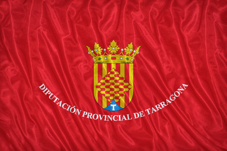 foreign land: Tarragona flag pattern on the fabric texture ,vintage style