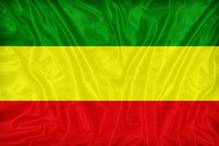 Rasta flag green,yellow,red pattern on fabric texture Stock Photo