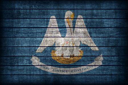 louisiana flag: Louisiana flag pattern on wooden board texture ,retro vintage style Stock Photo