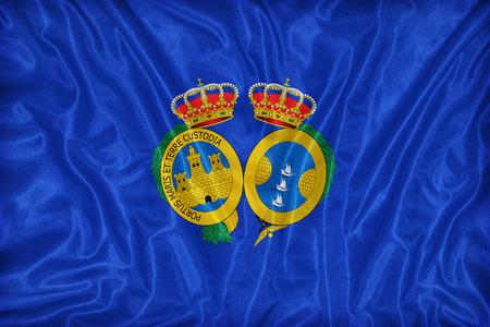 foreign land: Huelva flag pattern on fabric texture,retro vintage style Stock Photo
