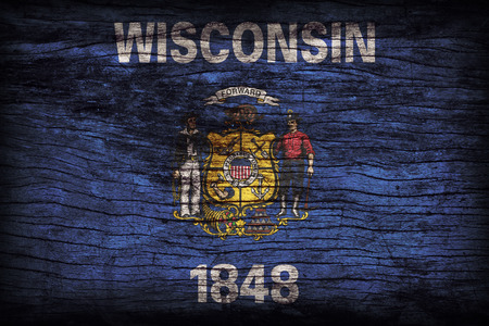 wisconsin flag: Wisconsin flag pattern on wooden board texture ,retro vintage style