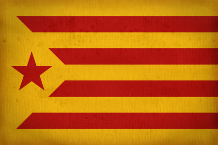 foreign land: Catalan Socialist Independentist red estelada flag pattern on fabric texture,retro vintage style