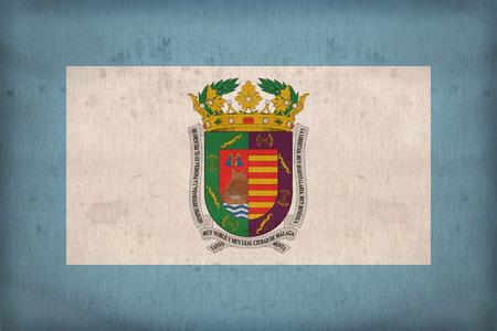 foreign land: Malaga flag pattern on fabric texture,retro vintage style