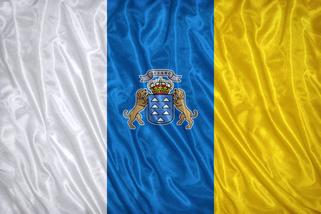 foreign national: Canary Islands flag pattern on the fabric texture ,vintage style Stock Photo