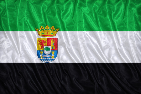 foreign land: Extremadura flag pattern on the fabric texture ,vintage style