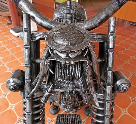 predators: AYUTTHAYA ,THAILAND- APRIL 25, 2015 : The Motorcycle with Aliens mixed Predators made from scrap metal at Tung Bua Chom floating market
