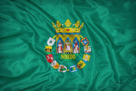 foreign land: Sevilla flag on fabric texture,retro vintage style