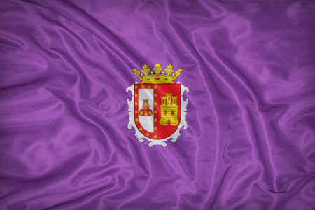 foreign land: Burgos flag on fabric texture,retro vintage style