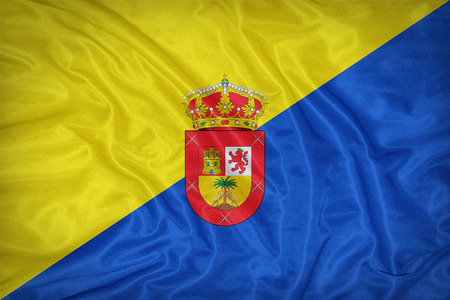 foreign land: Gran Canaria flag on fabric texture,retro vintage style