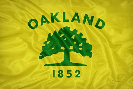 california flag: Oakland ,California flag on fabric texture,retro vintage style Stock Photo