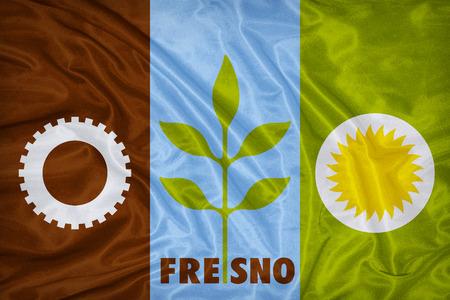 california flag: Fresno ,California flag on fabric texture,retro vintage style