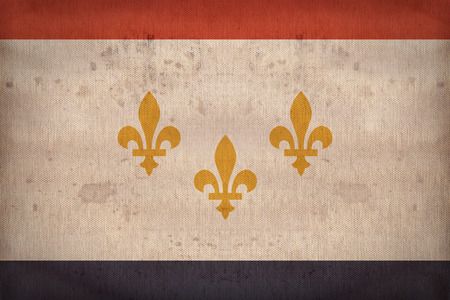new orleans: New Orleans ,Louisiana flag on fabric texture,retro vintage style