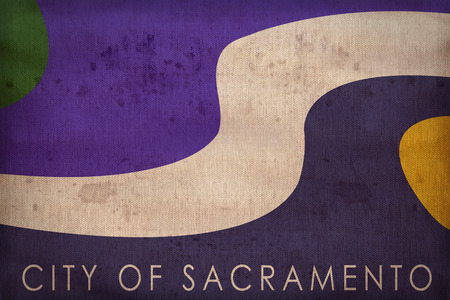california flag: Sacramento ,California flag on fabric texture,retro vintage style