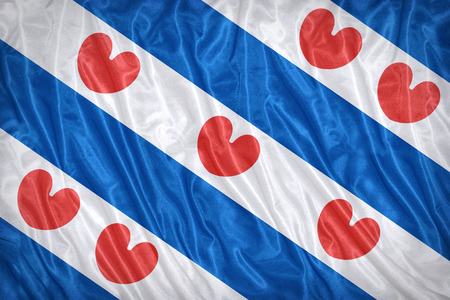 Flag of Friesland on the fabric texture ,vintage style Stock Photo
