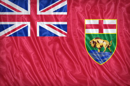 canadian state flag: Flag of Manitoba on the fabric texture ,vintage style