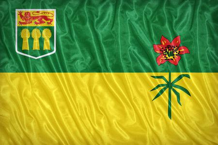 saskatchewan flag: Flag of Saskatchewan on the fabric texture ,vintage style
