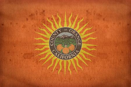orange county: Orange County , California flag on fabric texture,retro vintage style Stock Photo