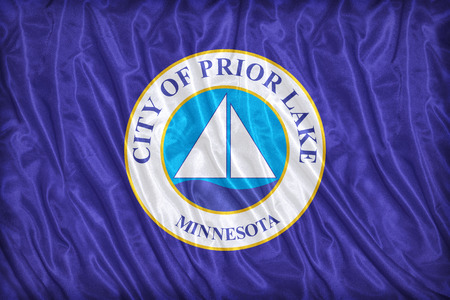prior lake: Prior Lake ,Minnesota flag pattern on the fabric texture ,vintage style Stock Photo