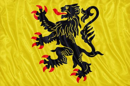 calais: Nord-Pas de Calais flag pattern on the fabric texture ,vintage style Stock Photo