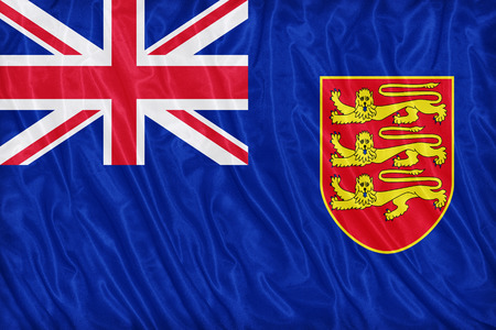 ensign: Government Ensign of Jersey flag pattern on the fabric texture ,vintage style Stock Photo