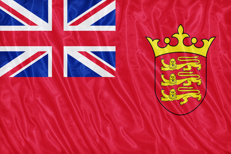 ensign: Civil Ensign of Jersey flag pattern on the fabric texture ,vintage style Stock Photo